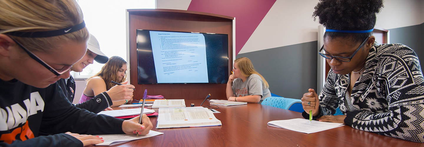 Students working on projects in Accounting with Professor Brown