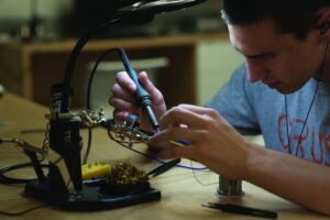 Scott Anderson soldering the board for the LENS